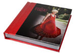 red leather integrity album with photo of female in red dress