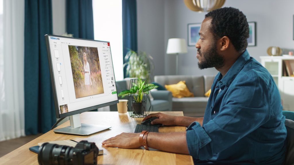 Photographer sitting at computer using McKenna Web