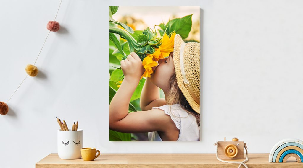 12x18 metal print of young girl smelling a sunflower